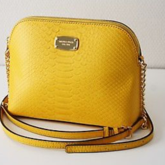 585780e897a0 Michael Kors Cindy Large Dome Crossbody Sunflower.  M_5c086a8ba31c33a12b008733. Other Bags you may like